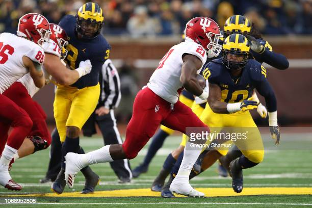Stevie Scott of the Indiana Hoosiers tries to get around Devin Bush of the Michigan Wolverines during a first half run at Michigan Stadium on...