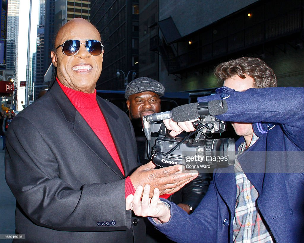 Stevie Wonder and Adam Glyn record an interview for TMZ after the 'Late Show with David Letterman' at Ed Sullivan Theater on March 11, 2015 in New York City.