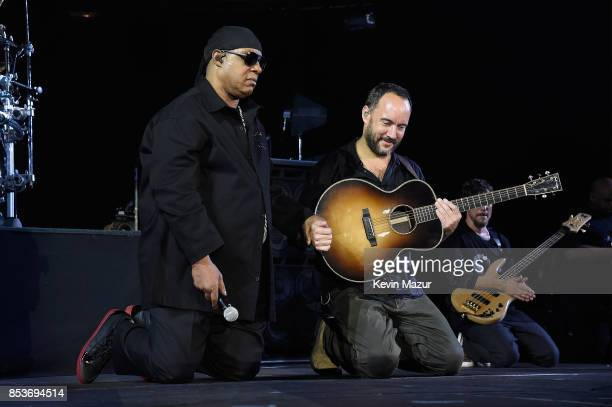 Stevie Wonder and Dave Matthews kneel onstage at A Concert for Charlottesville at University of Virginia's Scott Stadium on September 24 2017 in...
