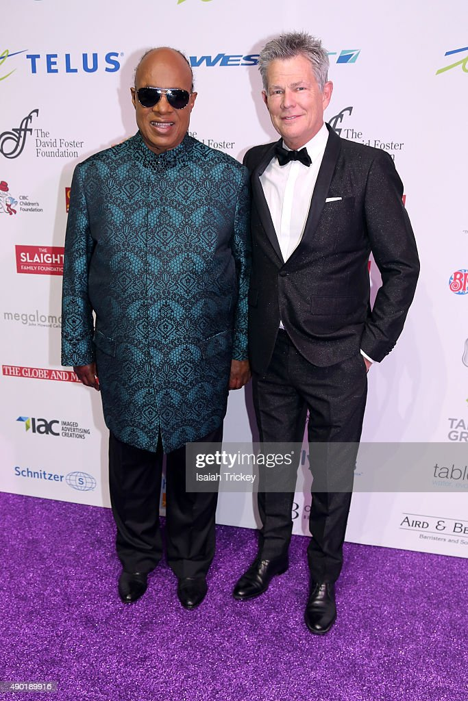 Stevie Wonder (L) and David Foster arrive at the David Foster Foundation Miracle Gala And Concert at Mattamy Athletic Centre on September 26, 2015 in Toronto, Canada.