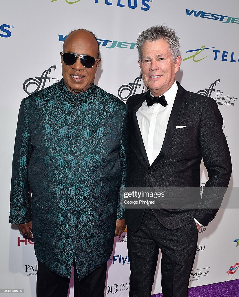 Stevie Wonder and David Foster attend David Foster Foundation Miracle Gala And Concert held at Mattamy Athletic Centre on September 26, 2015 in Toronto, Canada.