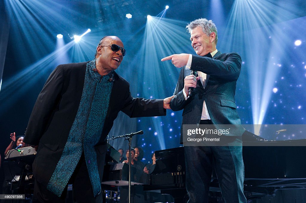 Stevie Wonder and David Foster perform at the David Foster Foundation Miracle Gala And Concert held at Mattamy Athletic Centre on September 26, 2015 in Toronto, Canada.