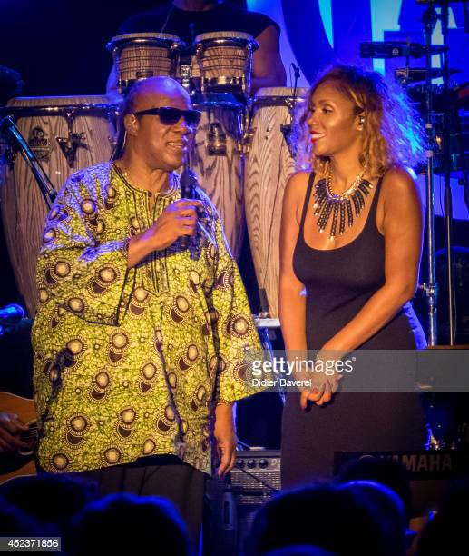 Stevie Wonder and his daughter Aisha Morris perform on stage at the 54th 'Jazz A Juan' Festival on July 18 2014 in JuanlesPins France