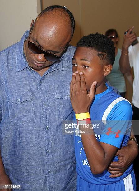 Stevie Wonder and his son Kailand Obasi attend the 2nd Annual Kailand Obasi HoopLife Friendraiser on September 13 2014 in Los Angeles California