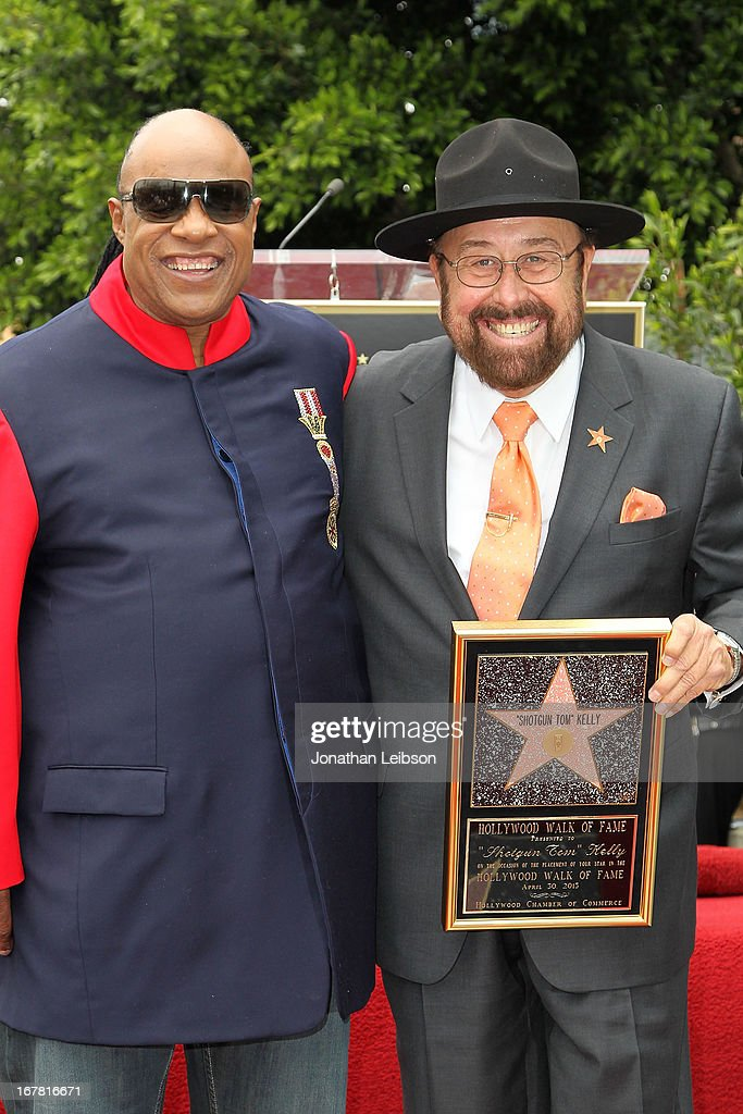 Stevie Wonder and 'Shotgun Tom' Kelly attend the ceremony honoring 'Shotgun Tom' Kelly with a star on The Hollywood Walk of Fame held on April 30, 2013 in Hollywood, California.