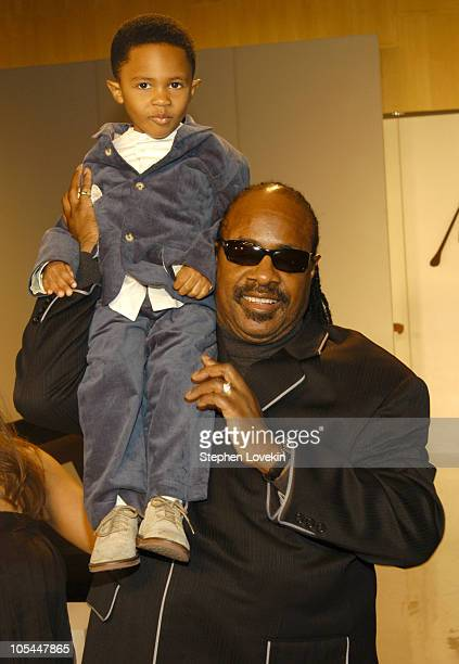 Stevie Wonder and son Kailand during Olympus Fashion Week Fall 2005 Kai Milla Front Row and Runway at The Newspace in New York City NY United States