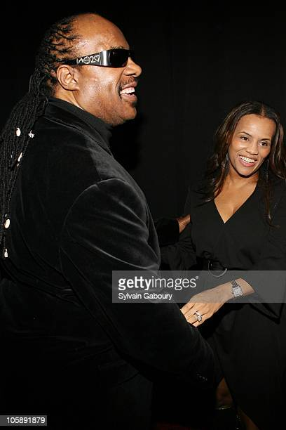 Stevie Wonder and wife Kai Milla during Olympus Fashion Week Fall 2006 Kai Milla Front Row and Backstage at New Yorker Hotel in New York City New...