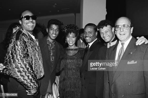 Stevie Wonder Babyface Whitney Houston LA Reid Narada Michael Walden and Clive Davis attend a party circa 1988