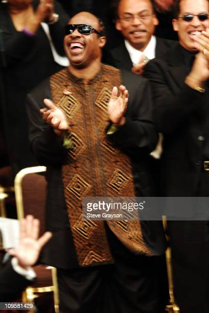 Stevie Wonder claps during the funeral service for the late Johnnie Cochran at the West Angeles Cathedral in Los Angeles California April 6 2005