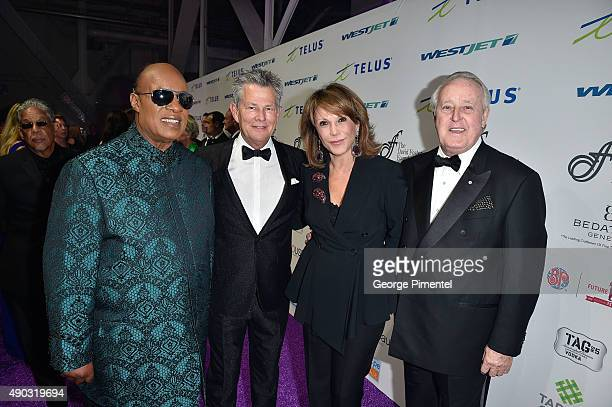 Stevie Wonder David Foster CEO of the David Foster Foundation Michael Ravenhill and wife Cassandra Ravenhill attend David Foster Foundation Miracle...