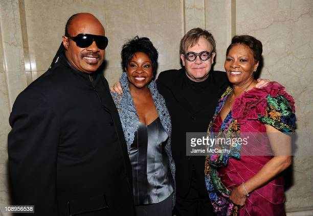 Stevie Wonder Gladys Knight Elton John and Dionne Warwick pose at the amfAR New York Gala to kick off Fall 2011 Fashion Week at Cipriani Wall Street...