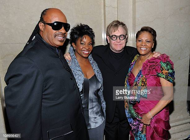 Stevie Wonder Gladys Knight Elton John and Dionne Warwick pose backstage the amfAR New York Gala to kick off Fall 2011 Fashion Week at Cipriani Wall...