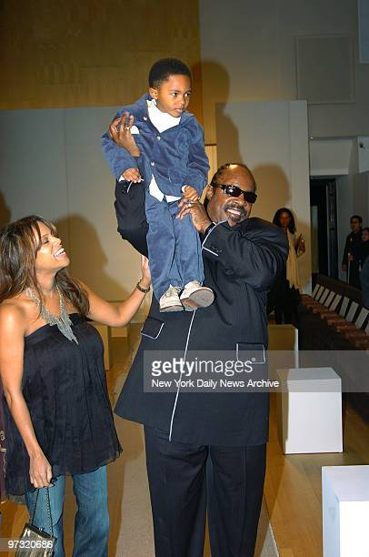 Stevie Wonder hoists son Kailand as his wife Kai Milla looks on She's launching a line of clothes during Fashion Week festivities in Bryant Park