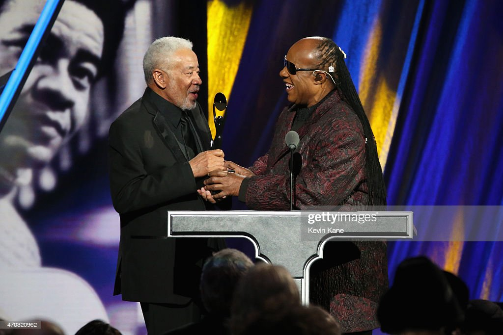 Stevie Wonder (R) inducts Bill Withers onstage during the 30th Annual Rock And Roll Hall Of Fame Induction Ceremony at Public Hall on April 18, 2015 in Cleveland, Ohio.