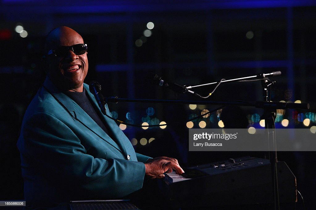 Stevie Wonder performs at SeriousFun Children's Network event honoring Liz Robbins with celebrity guests at Pier Sixty at Chelsea Piers on April 4, 2013 in New York City.