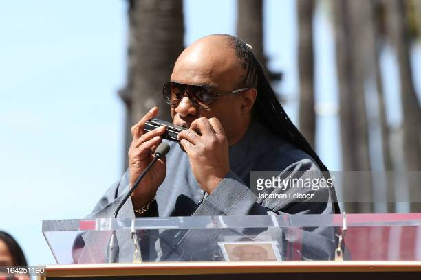 Stevie Wonder performs at the honoring of The Funk Brothers star on the Hollywood Walk of Fame on March 21 2013 in Hollywood California