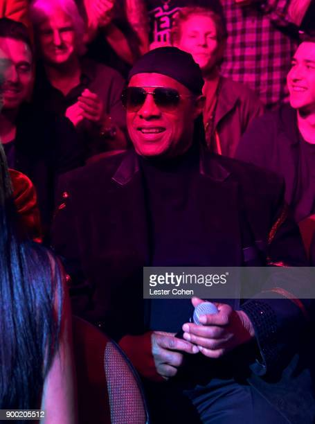 Stevie Wonder performs from the audience during Dave Chappelle and John Mayer Controlled Danger at The Forum on December 31 2017 in Inglewood...
