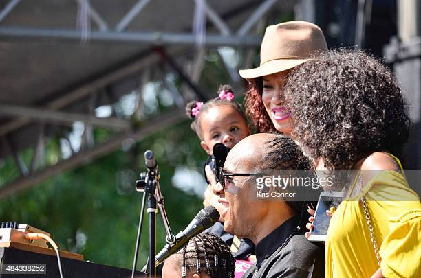 Stevie Wonder performs with his children during an exclusive press conference and performance on the Armory Mall on August 17 2015 in Washington DC...