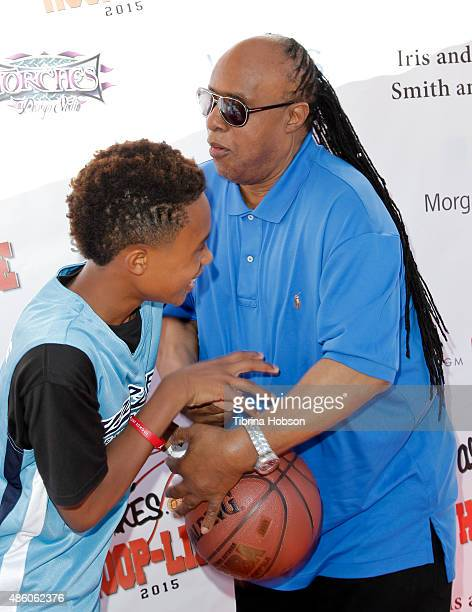 Stevie Wonder plays around with his son Kailand Morris at the 3rd annual HoopLife FriendRaiser at Galen Center on August 30 2015 in Los Angeles...
