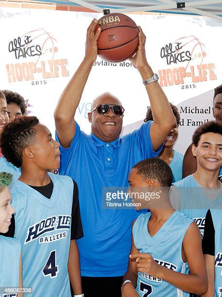 Stevie Wonder plays around with his sons Kailand Morris and Mandla Morris at the 3rd annual HoopLife FriendRaiser at Galen Center on August 30 2015...
