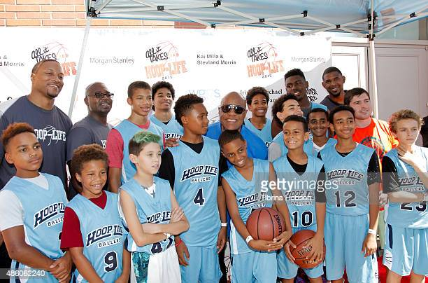 Stevie Wonder poses with his sons basketball team at the 3rd annual HoopLife FriendRaiser at Galen Center on August 30 2015 in Los Angeles California