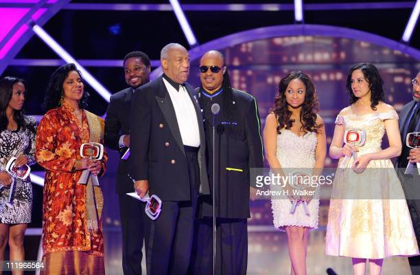Stevie Wonder presents the Impact Award to The Cosby Show cast Keshia Knight Pulliam Phylicia Rashad MalcolmJamal Warner Bill Cosby RavenSymone and...