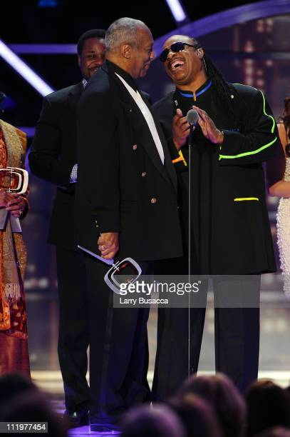 """Stevie Wonder presents The Impact Award to """"The Cosby Show"""" cast with actor Bill Cosby onstage at the 9th Annual TV Land Awards at the Javits Center..."""