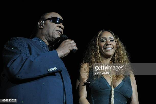 Stevie Wonder with his daughter Aisha Morris as he speaks to the audience before his performance during his Songs in the Key of Life Tour March 17...