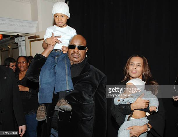Stevie Wonder with son Kailand and Kai Milla holding son Mandla