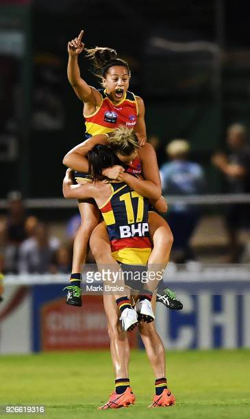 StevieLee Thompson Ebony Marinoff and Jessica Sedunary of the Adelaide Crows at the final siren during the round five AFLW match between the Adelaide...