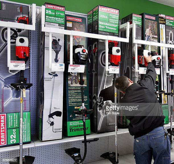Stevo Zrhic shops for Searsbrand Craftsman Weedwackers in a newly revamped Kmart store April 22 2005 in Norridge Illinois This particular store is...