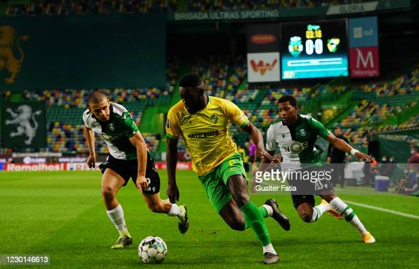 Stevy Okitokandjo of CD Mafra with Eduardo Quaresma of Sporting CP and Gonzalo Plata of Sporting CP in action during the Portuguese League Cup match...