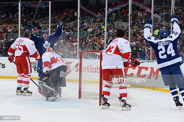 Stew Gavin of the Toronto Maple Leafs celebrates his first period goal against the Detroit Red Wings during the 2013 Hockeytown Winter Festival...