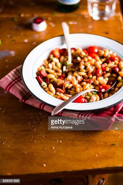 stew with sausages, white kidney beans and cherry tomatoes, selective focus - traditionally hungarian stock pictures, royalty-free photos & images