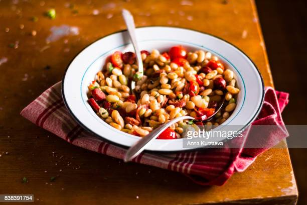 stew with sausages, white kidney beans and cherry tomatoes, selective focus - hungarian culture stock photos and pictures