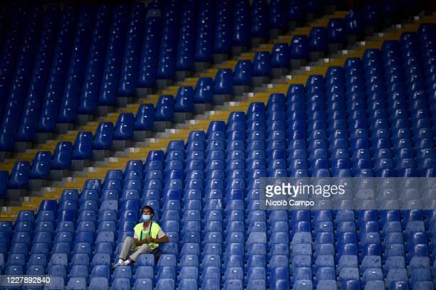 Steward amidst empty seats at stadio Luigi Ferraris looks on prior to the Serie A football match between Genoa CFC and Hellas Verona. Italian...