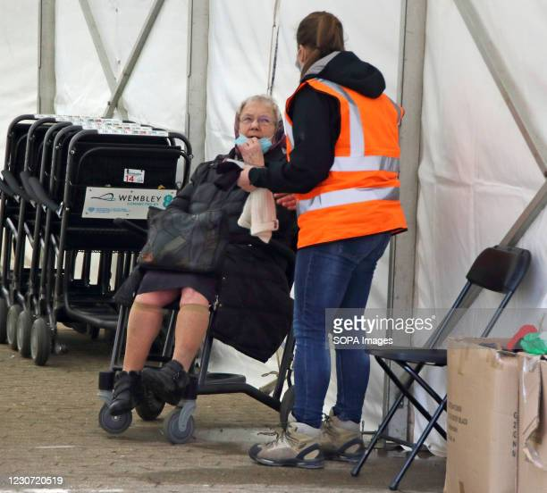 Steward attends to an elderly woman inside the vaccination centre entrance. A steady stream of elderly people with pre-booked appointments at the new...
