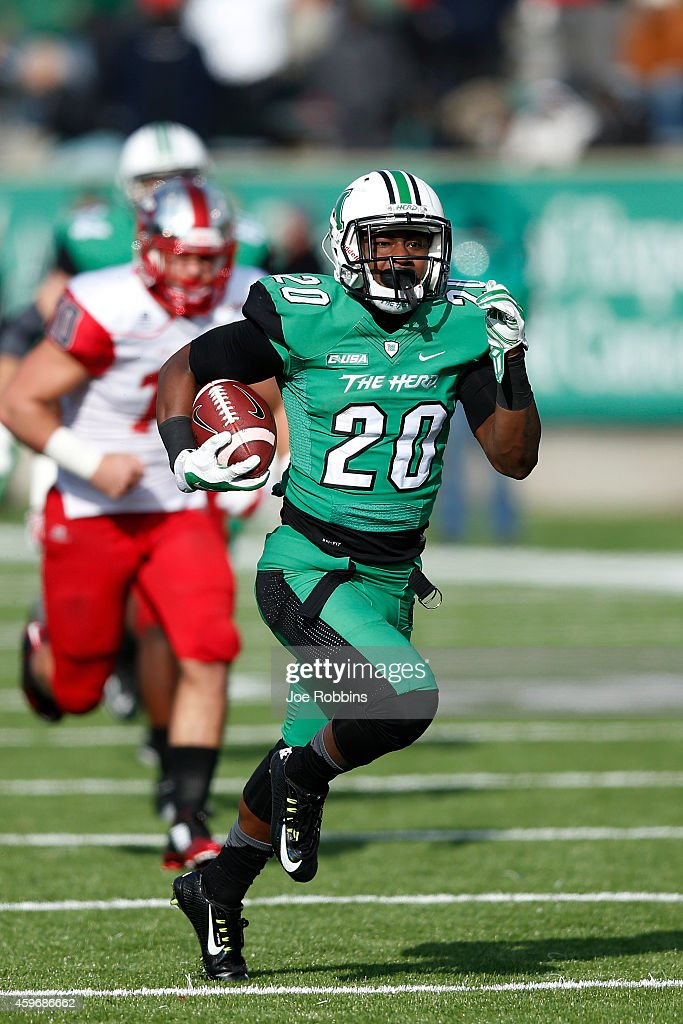 Steward Butler #20 of the Marshall Thundering Herd rushes for a 48-yard touchdown in the first half of the game against the Western Kentucky Hilltoppers at Joan C. Edwards Stadium on November 28, 2014 in Huntington, West Virginia.