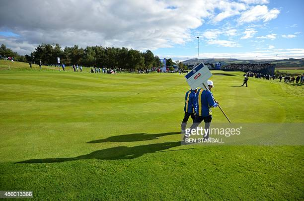 A steward carries an information placard during a practice round at the Gleneagles golf course in Gleneagles Scotland on September 24 ahead of the...
