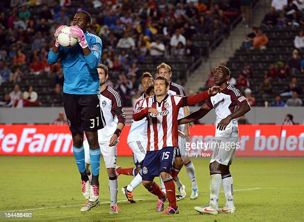 Steward Ceus of the Colorado Rapids steps in front of Alejandro Moreno of Chivas USA and teammate Hendry Thomas to block a corner kick during the...