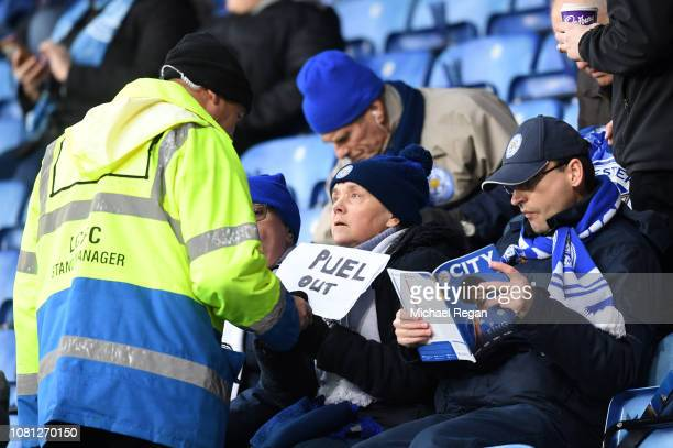 Steward confiscates a 'Puel Out' sign from a Leicester City fan prior to the Premier League match between Leicester City and Southampton FC at The...