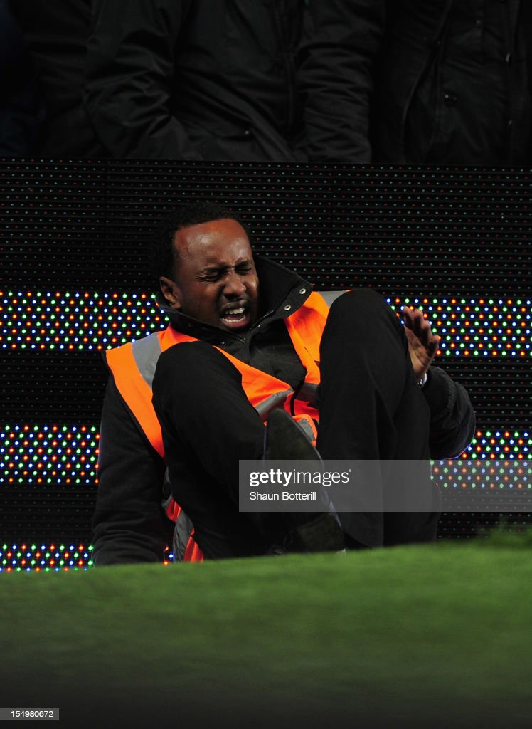 A steward grimaces pitchside during the Barclays Premier League match between Chelsea and Manchester United at Stamford Bridge on October 28, 2012 in London, England.