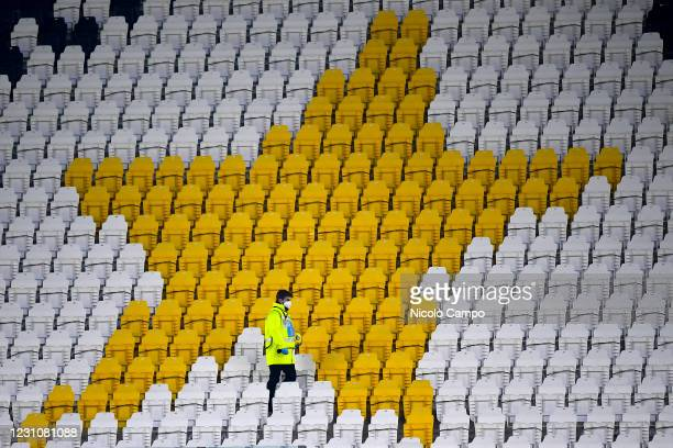 Steward holds the ball amidst empty seats during the Coppa Italia football match between Juventus FC and FC Internazionale. Sporting stadiums around...