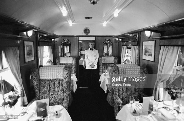 A steward in the dining car of the Orient Express as it leaves Victoria Station London 25th May 1982