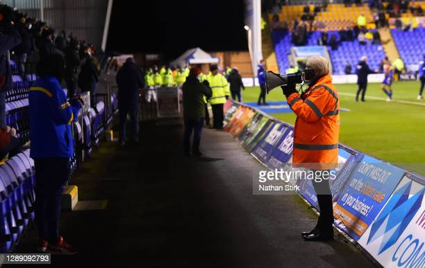 Steward instruct the fans out of the ground during the Sky Bet League One match between Shrewsbury Town and Accrington Stanley at Montgomery Waters...