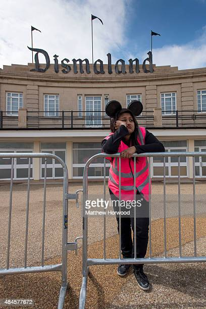 A steward is seen outside Banksy's 'Dismaland' exhibition which opens tomorrow at a derelict seafront lido on August 20 2015 in WestonSuperMare...