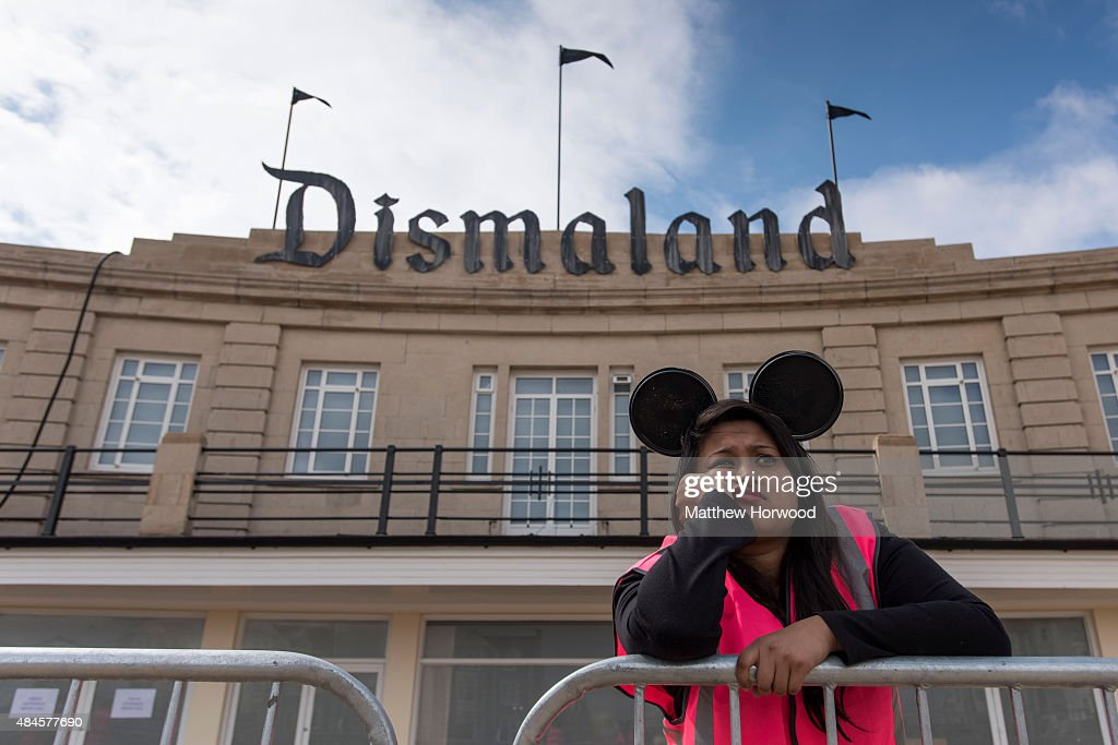 A steward is seen outside Banksy's 'Dismaland' exhibition, which opens tomorrow, at a derelict seafront lido on August 20, 2015 in Weston-Super-Mare, England. The show is Banskys first in the UK since the Banksy v Bristol Museum show in 2009 and will be open for 5 weeks at the Topicana site.