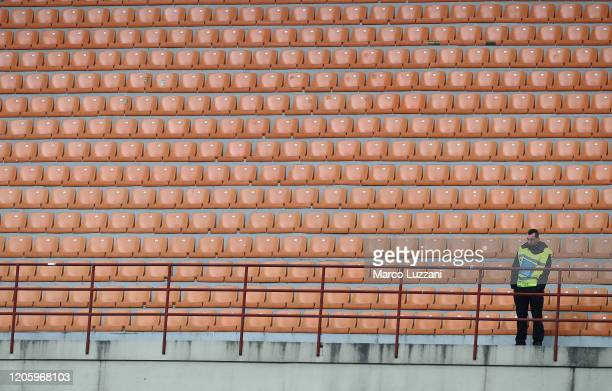 Steward looks on from an empty stand during the Serie A match between AC Milan and Genoa CFC at Stadio Giuseppe Meazza on March 8, 2020 in Milan,...