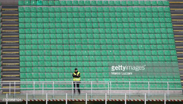 Steward looks on from an empty stand during the Serie A match between AC Milan and Genoa CFC which is being played in a closed stadium at Stadio...