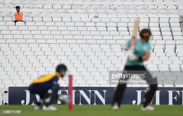 Steward looks on from an otherwise empty stand during the Vitality T20 match between Surrey and Essex Eagles at The Kia Oval on August 30, 2020 in...